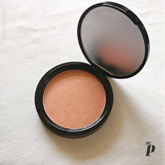 NYX Highlighter Illuminator Magnetic Review Swatches on dark skin_pan packaging rear